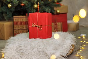 Red gift under Christmas tree