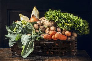 Harvest vegetables in wooden box