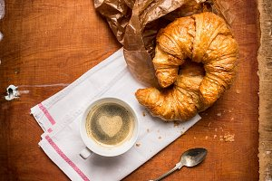Coffee with a heart and croissants