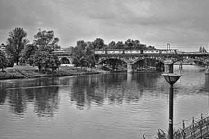 Train crossing a bridge over a river