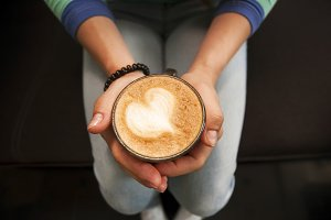 The cup of coffee in hands