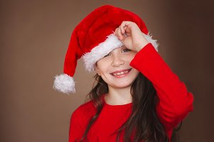 happy little girl with santa hat