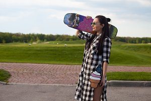The woman is with skate