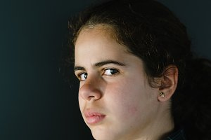 Headshot portrait of defiant teenager