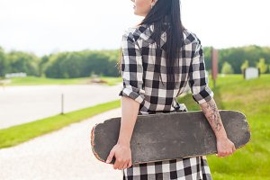 The woman holds a skate