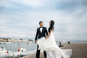 Groom walks with whirling bride