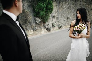 Groom looks at brunette bride