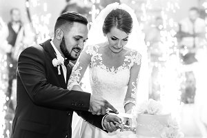 Wedding couple cutting a cake