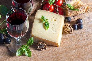 Cheese with red wine and walnuts