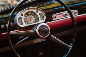 Close-up of steering wheel of a vintage car