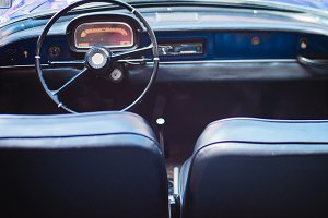 Black leather interior of a vintage car