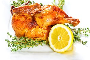 Grilled chicken with herbs and lemon