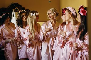 Happy bride and bridesmaids in silk