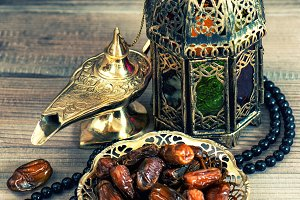 dates, arabic lantern and rosary