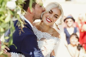 Groom kisses bride's cheek
