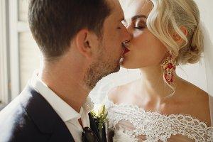 Soft kiss of gorgeous wedding couple