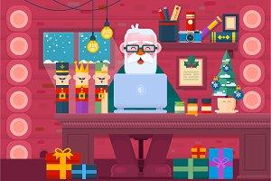Santa Claus using a laptop.Christmas Greeting Card Design. Work space interior.Flat vector illustration