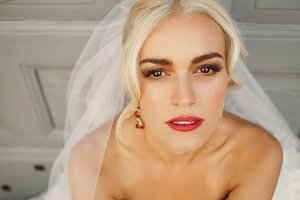 Blonde bride squints her eyes