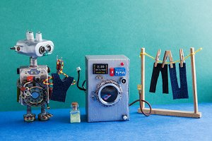 Robot automation laundry room. Silver washing machine, men's jeans pants dried on clothesline with clothespins. Green wall interior, blue floor. Funny toys creative design.
