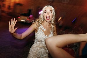 Blonde bride looks funny dacning