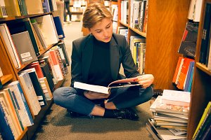 Student girl sit read in library