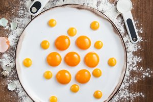 Bakery ingredients - flour, eggs, butter, sugar, yolk. Sweet pastry baking concept. Flat lay, top view.