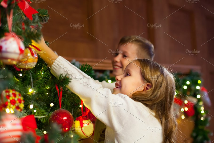 portrait of happy children decorating christmas treefamily chr people - People Decorating A Christmas Tree