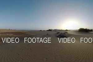Timelapse of people in the distance walking on Maspalomas Dunes, Gran Canaria