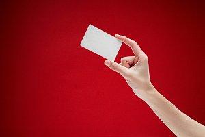 Female hand holding card