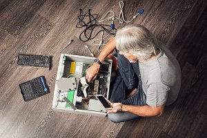 Senior Man Assembling Computer