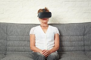 Senior Woman Wearing Vr Glasses