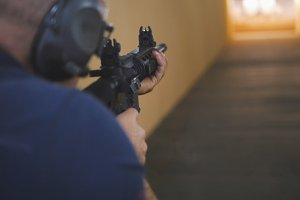 Man instructor have shooting with a Machinegun at the shooting gallery