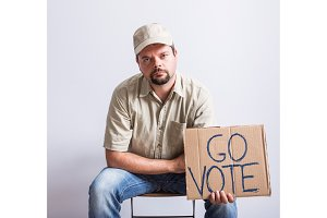 Truck Driver Holding Go Vote Sign