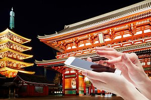 Female hand holding mobile phone for