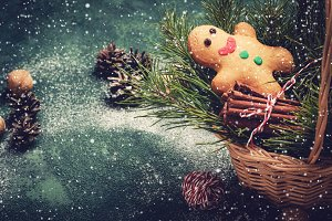 gingerbread man and coniferous branches in basket