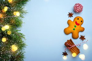 Christmas blue background with gingerbread man and spices