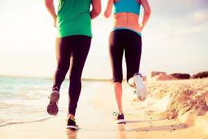 Young Couple Jogging On The Beach