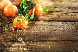 Mandarins Tangerines on wooden background. Copy space for your text. Bokeh and lights, toned effect
