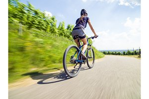 Young Woman On Mountain Bike