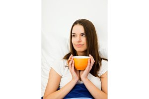 Beautiful Woman Having Coffee In Bed