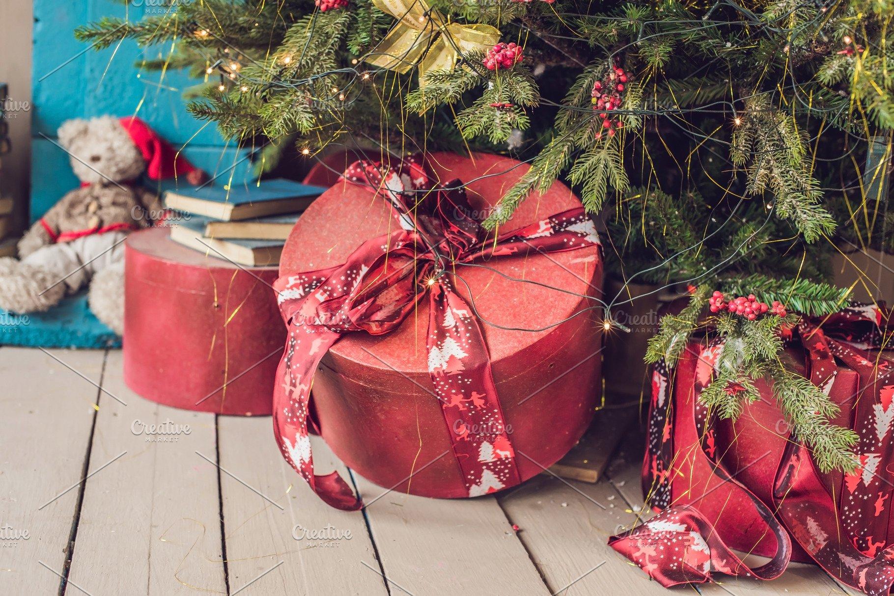 Various Christmas Presents Under The Illuminated Christmas Tree