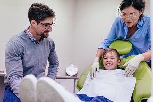 Little boy visiting dentist at clini