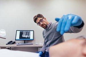Stomatologist examining teeth