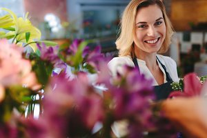 Smiling florist working in her shop.