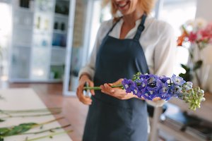 Female florist creating bouquet