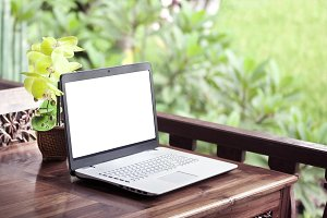 Laptop on wooden table nature