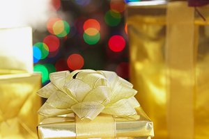 Gold foil wrapped Christmas presents