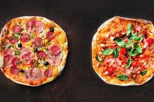 Pizza pattern. Six pieces set on dark background. Top view, copyspace
