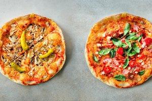 Pizza pattern. Six pieces set on grey concrete background. Top view, copyspace