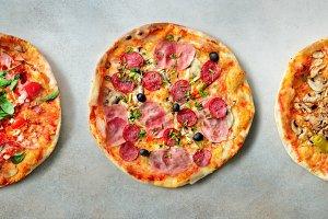 Pizza pattern. Nine pieces set on grey concrete background. Top view, copyspace